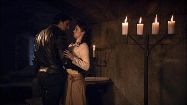 Marian strains away from Guy's embrace (Robin Hood S1 E11) Source:  www.richardarmitagenet.com
