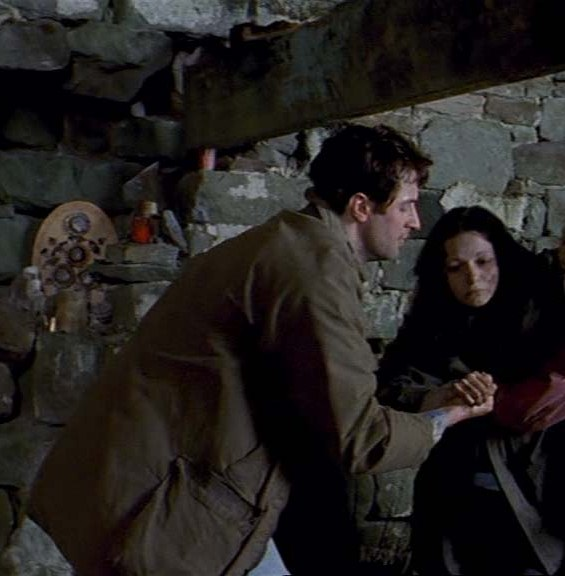 John helps Carol out of the ruins... Source:  www.richardarmitagenet.com