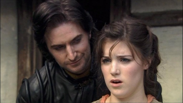 A downright saturnine looking Guy of Gisborne (Richard Armitage) woos a reluctant Marian (Lucy Griffiths) with gifts
