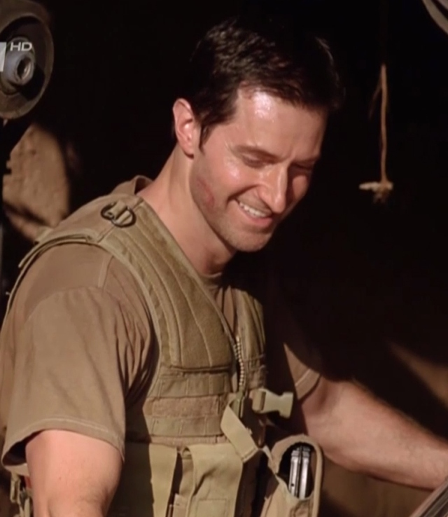 A rare-ish John Porter smile..Strikeback S1E4 Source:  www.richardarmitagenet.com (my crop)
