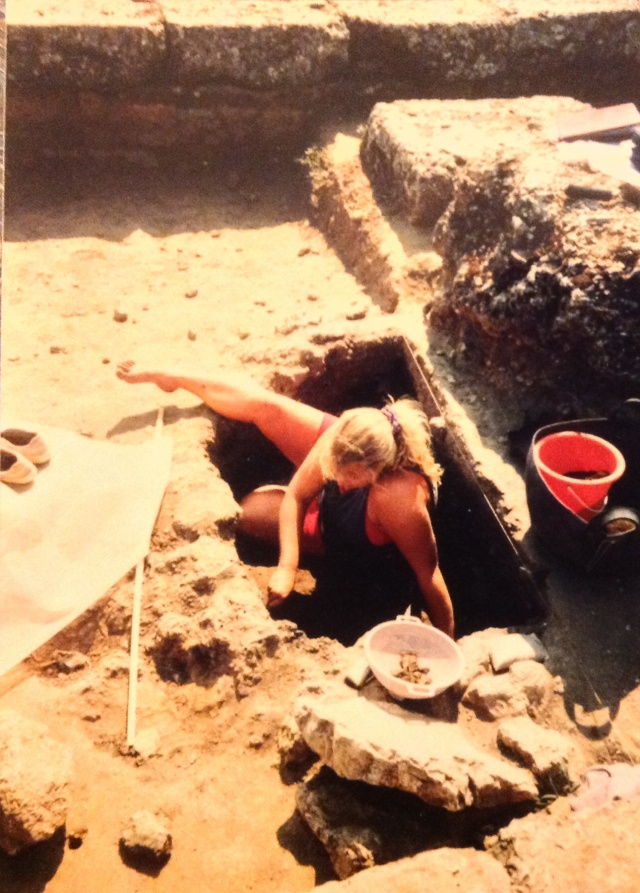 Sometimes the only way to get the job done is to get down in that hole...by the end of the season, that home was so deep that no one could see me!  (Yes, that is a red beach sand bucket)