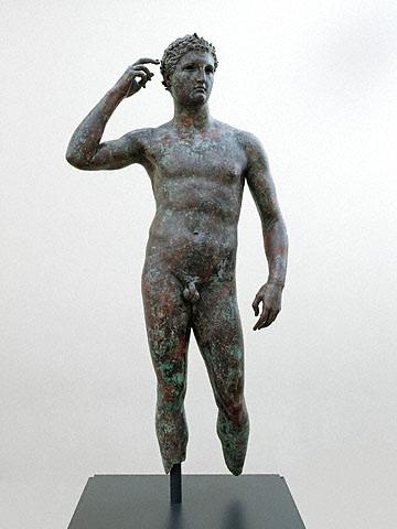 Ολυμπιονίκη celebration statue...his right hand is raised to the red ribbon that would have been around his head. Source:  J.P. Getty