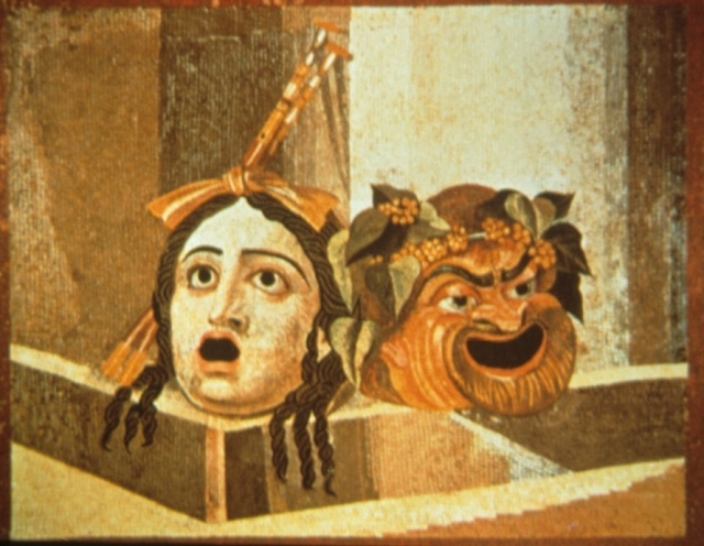 Roman mosaics depicting theatrical masks...on tragic, one comic.  From Pompeii