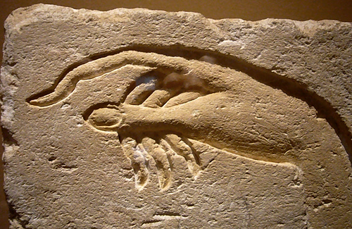 Relief sculpture of the arachnodactylic (spider-like) hands of an Amarna Period royal