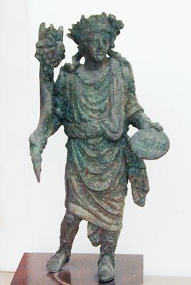 one of the Penates holding a cornu copiae and a patera (Source)